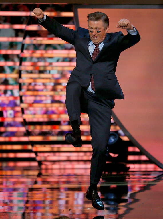 . Host Alec Baldwin jumps during his monologue at the NFL Honors award show in New Orleans, Louisiana February 2, 2013.      REUTERS/Jeff Haynes