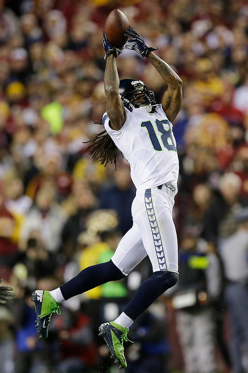 . Seattle Seahawks wide receiver Sidney Rice pulls in a pass during the first half of an NFL wild card playoff football game against the Washington Redskins in Landover, Md., Sunday, Jan. 6, 2013. (AP Photo/Matt Slocum)