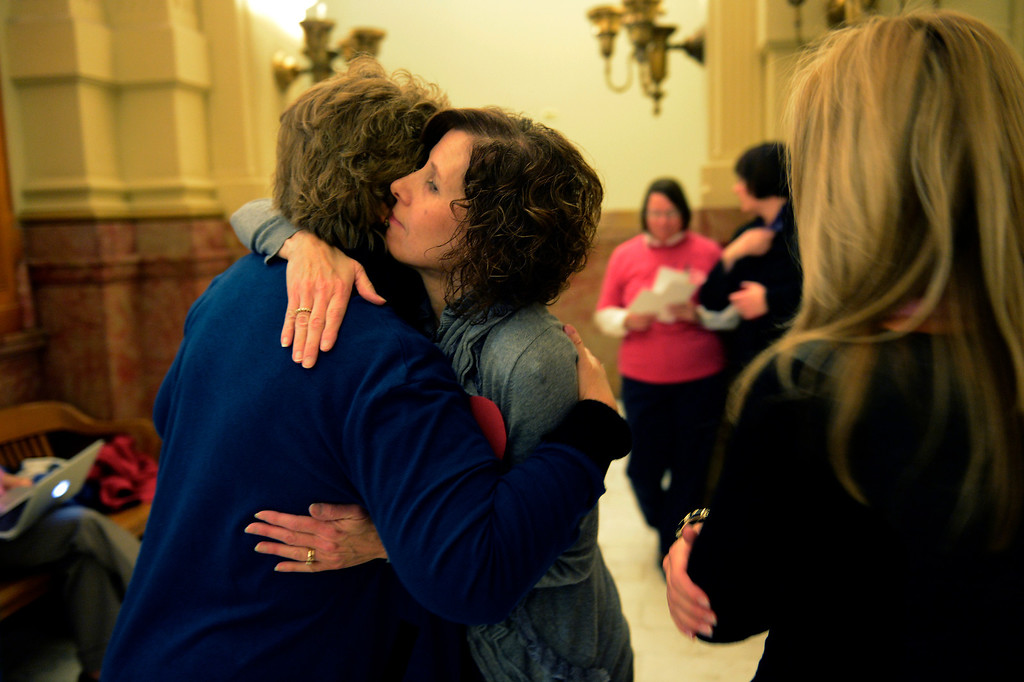 . DENVER, CO. - MARCH 08: Jane Dougherty the sister of Sandy Hook school psychologist Mary Joy Sherlach hugs Senator Nancy Todd at the Denver Senate before the vote on gun measures at the Denver State Capitol March 08, 2013 Denver, Colorado. (Photo By Joe Amon/The Denver Post)