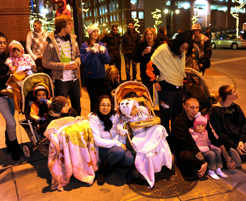 . Hot chocolate and extra blankets kept the kids warm Friday night. The annual Parade of Lights filed wound its way through downtown Denver Friday night, November 30. 2012. The parade with 11 floats, 7 bands, 5 giant balloons and more lights than anyone could count, had enough holiday spirit to cheer even the biggest Scrooge. A repeat performance is on tap for Saturday night. Karl Gehring/ The Denver Post