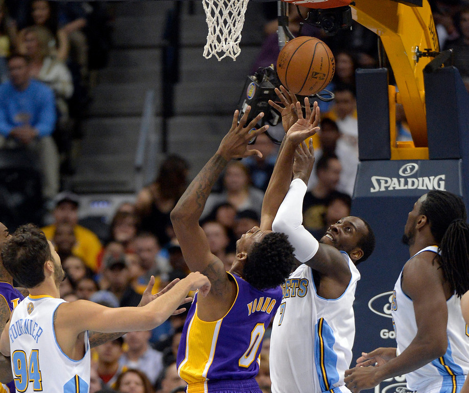 . DENVER, CO - NOVEMBER 13:Denver Nuggets power forward J.J. Hickson (7) battles with Los Angeles Lakers small forward Nick Young (0) for the ball during the second quarter November 13, 2013 at Pepsi Center. (Photo by John Leyba/The Denver Post)