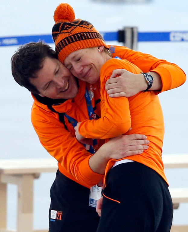 . A coach hugs an emotional Carien Kleibeuker of the Netherlands after it became clear she won a bronze in the women\'s 5,000-meter speedskating race at the Adler Arena Skating Center during the 2014 Winter Olympics in Sochi, Russia, Wednesday, Feb. 19, 2014. (AP Photo/Pavel Golovkin)