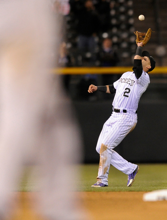 . DENVER, CO. - APRIL 19:  Colorado shortstop Troy Tulowitzki made the final out of the game. The Colorado Rockies defeated the Arizona Diamondbacks 3-1 at Coors Field Friday night, April 19, 2013.  Photo By Karl Gehring/The Denver Post)