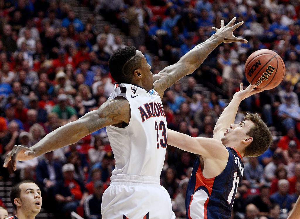 . David Stockton #11 of the Gonzaga Bulldogs goes up against Rondae Hollis-Jefferson #23 of the Arizona Wildcats in the first half during the third round of the 2014 NCAA Men\'s Basketball Tournament at Viejas Arena on March 23, 2014 in San Diego, California.  (Photo by Donald Miralle/Getty Images)