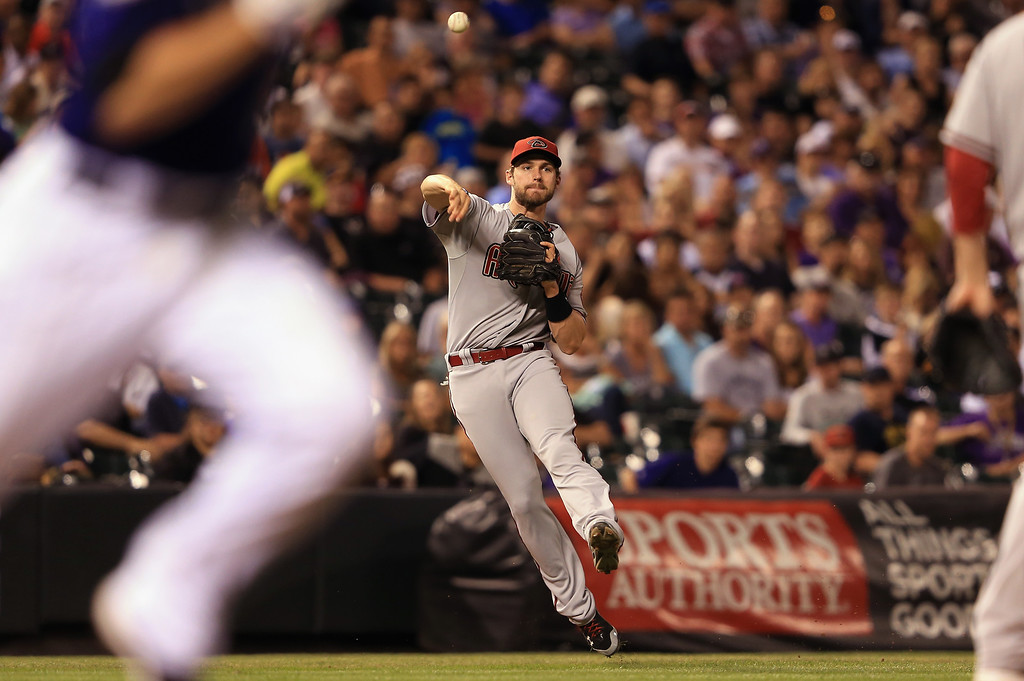 . DENVER, CO - SEPTEMBER 21:  Third baseman Matt Davidson #24 of the Arizona Diamondbacks is unable to make the play as Josh Rutledge #14 of the Colorado Rockies singles in the sixth inning at Coors Field on September 21, 2013 in Denver, Colorado.  (Photo by Doug Pensinger/Getty Images)
