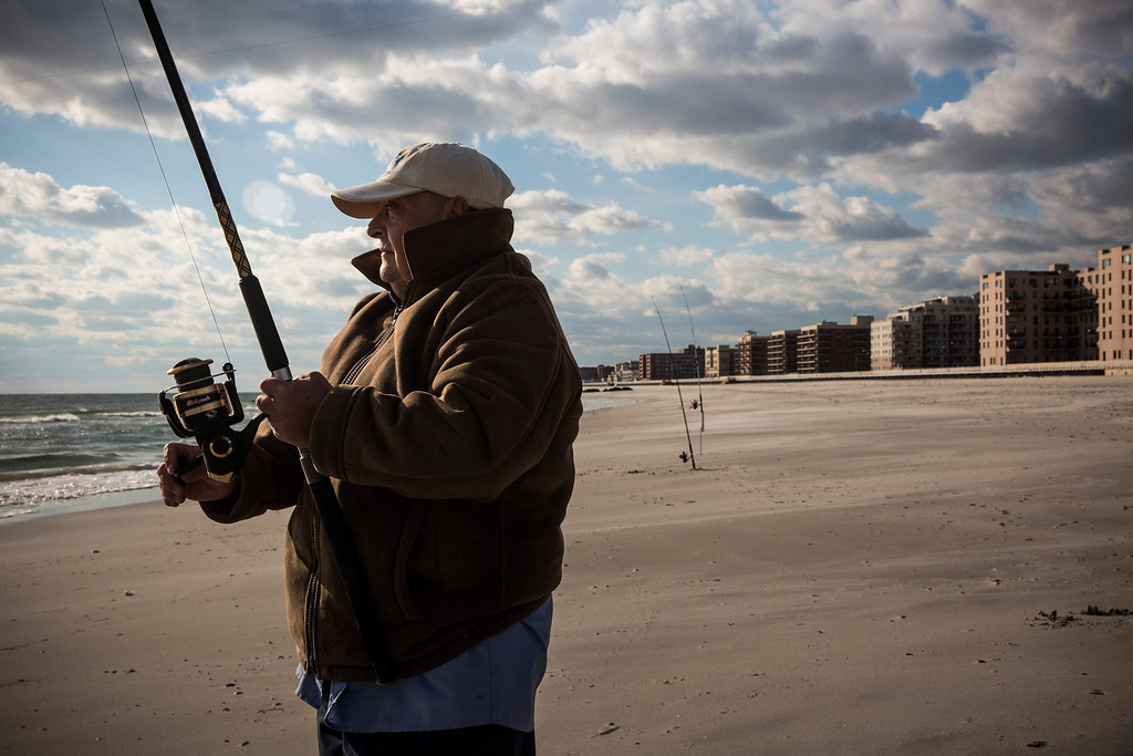 . LONG BEACH, NY - OCTOBER 25:  Louis Medina fishes for striped bass on October 25, 2013 in Long Beach, New York. The Long Beach boardwalk was severely damaged by Superstorm Sandy last year, which killed 285 people and caused billions of dollars in damage, though the boardwalk reopened today. Long Beach\'s new boardwalk is made of Brazilian hardwood and is estimated to have a lifespan of 30-40 year; the previous boardwalk was only scheduled to last  three to seven years.  (Photo by Andrew Burton/Getty Images)