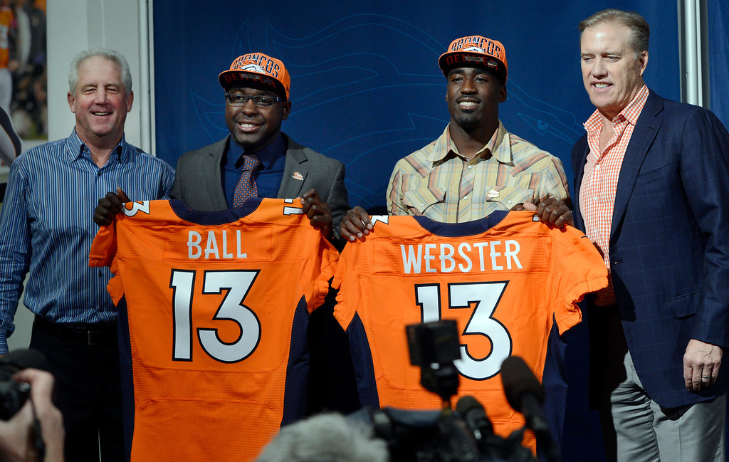 . ENGLEWOOD, CO. - APRIL 27: Denver Broncos Head Coach John Fox, left and Executive Vice President of Football Operations John Elway, right, introduce RB Montee Ball and CB Kayvon Webster, during a press conferences at the team�s training facility, in Englewood, CO April 27, 2013. (Photo By Craig F. Walker/The Denver Post)