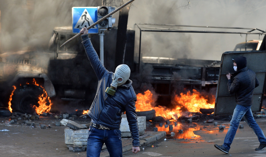 . Anti-government protesters clash with police in front of the Ukrainian Parliment in Kiev on February 18, 2014. At least three anti-government protesters were killed and some 150 others injured, some seriously, today in fresh clashes between police and demonstrators protesting near Ukraine\'s parliament building in Kiev. Medics at an opposition-run field hospital said that most of the injuries were caused by stun grenades while some of the 30 people in a serious condition had suffered head injuries, and one person had to have a hand amputated. AFP PHOTO / SERGEI  SUPINSKY/AFP/Getty Images