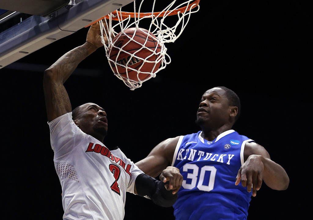 . Russ Smith #2 of the Louisville Cardinals dunks the ball over Julius Randle #30 of the Kentucky Wildcats during the regional semifinal of the 2014 NCAA Men\'s Basketball Tournament at Lucas Oil Stadium on March 28, 2014 in Indianapolis, Indiana.  (Photo by Jonathan Daniel/Getty Images)