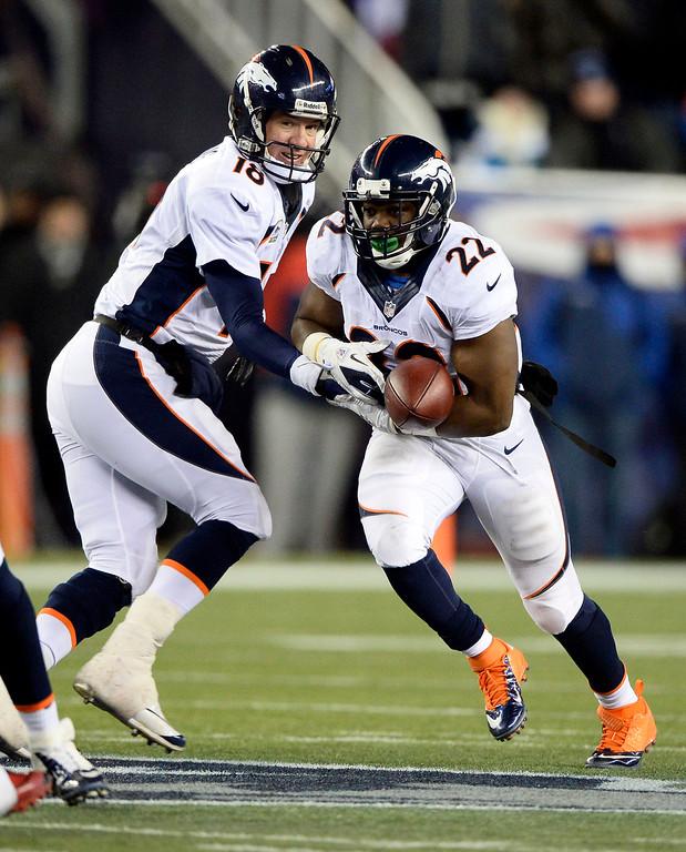 . Denver Broncos running back C.J. Anderson mis handles a handoff by Denver Broncos quarterback Peyton Manning (18) during the overtime period against the New England Patriots November 24, 2013 at Gillette Stadium. (Photo by John Leyba/The Denver Post)