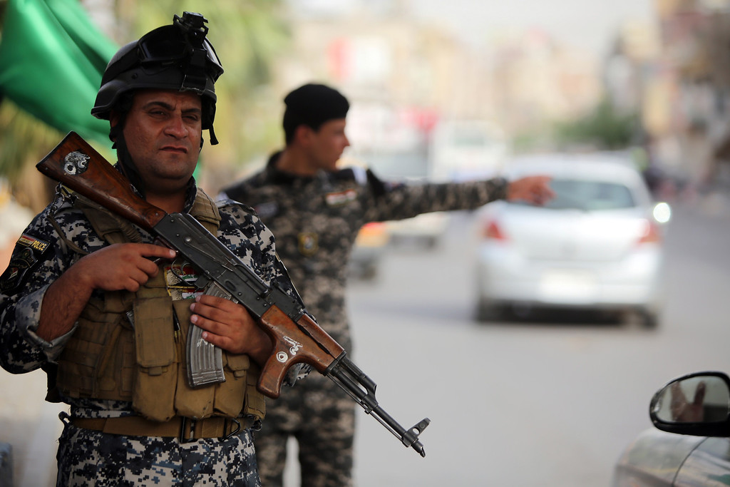 . Iraqi policemen man a checkpoint in the capital Baghdad on June 10, 2014, after a state of emergency was declared by the government. Jihadists seized Iraq\'s second city of Mosul and the surrounding Nineveh province on Tuesday, in a major blow to a government apparently incapable of stopping militant advances. AHMAD AL-RUBAYE/AFP/Getty Images