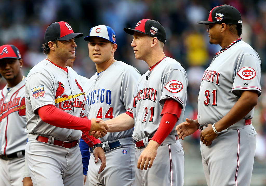 . National League All-Star Manager Mike Matheny of the St. Louis Cardinals  greets Todd Frazier #21 of the Cincinnati Reds  during the 85th MLB All-Star Game at Target Field on July 15, 2014 in Minneapolis, Minnesota.  (Photo by Elsa/Getty Images)