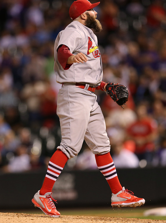 . St. Louis Cardinals relief pitcher Jason Motte jumps in air after striking out Colorado Rockies\' Troy Tulowitzki for the final out in the ninth inning of the Cardinals\' 8-0 victory in a baseball game in Denver on Monday, June 23, 2014. (AP Photo/David Zalubowski)