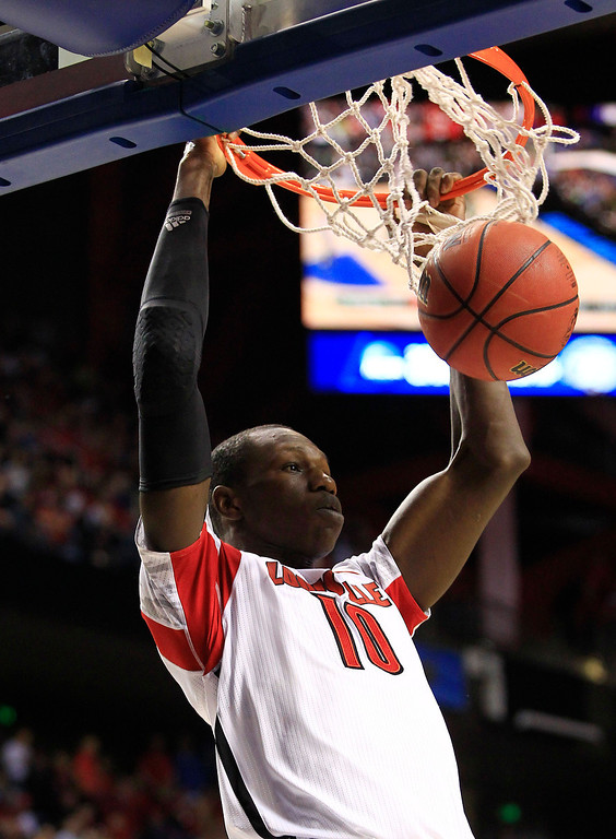 . Louisville center Gorgui Dieng (10) scores against Colorado State in the first half of a third-round NCAA college basketball tournament game on Saturday, March 23, 2013, in Lexington, Ky. (AP Photo/James Crisp)