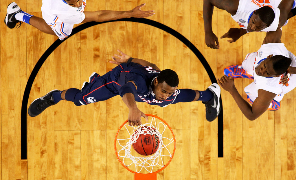 . ARLINGTON, TX - APRIL 05: DeAndre Daniels #2 of the Connecticut Huskies dunks against the Florida Gators during the NCAA Men\'s Final Four Semifinal at AT&T Stadium on April 5, 2014 in Arlington, Texas.  (Photo by Ronald Martinez/Getty Images)
