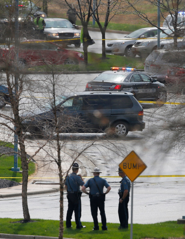 . Kansas State Troopers stand outside a police line near the location of a shooting at the Jewish Community Center in Overland Park, Kan., Sunday, April 13, 2014. (AP Photo/Orlin Wagner)