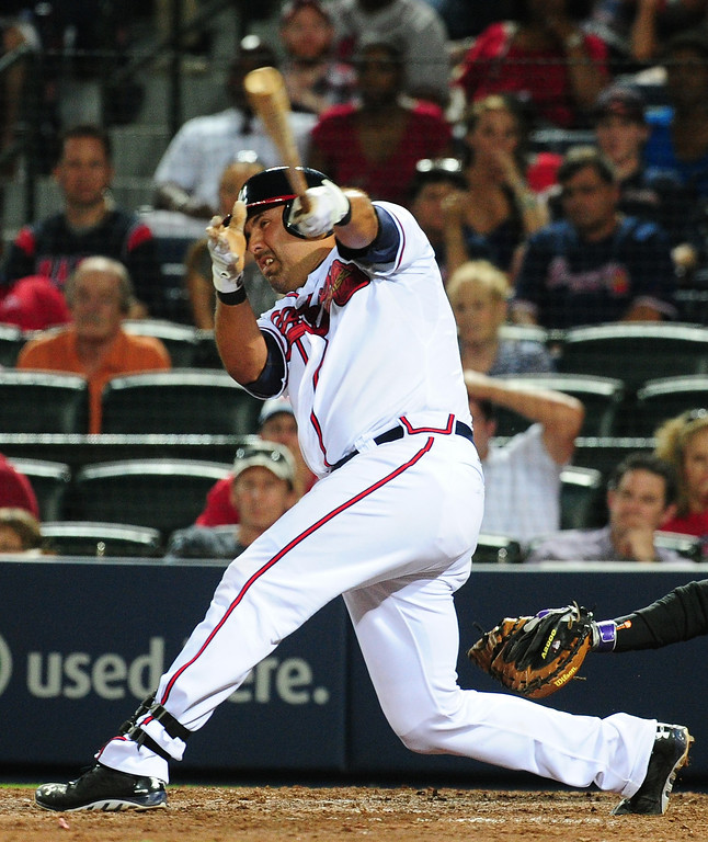 . ATLANTA, GA - MAY 23: Gerald Laird #11 of the Atlanta Braves doubles to knock in the go-ahead run in the 8th inning against the Colorado Rockies at Turner Field on May 23, 2014 in Atlanta, Georgia. (Photo by Scott Cunningham/Getty Images)