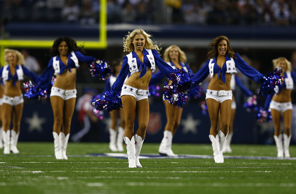 . The Dallas Cowboys cheerleaders perform during a game against the Washington Redskins at AT&T Stadium on October 13, 2013 in Arlington, Texas.  (Photo by Tom Pennington/Getty Images)