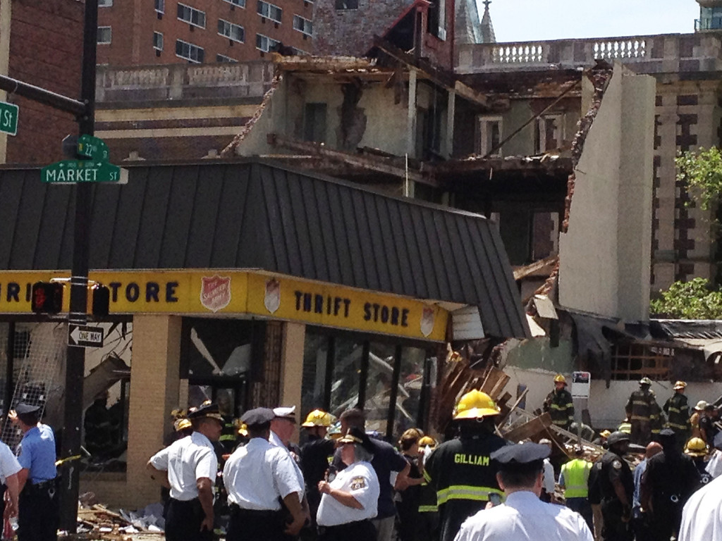 . Emergency personnel respond to a building collapse in downtown Philadelphia, where the city fire commissioner says as many as eight to 10 people are believed trapped in the rubble, Wednesday, June 5, 2013. (AP Photo/Jacqueline Larma)