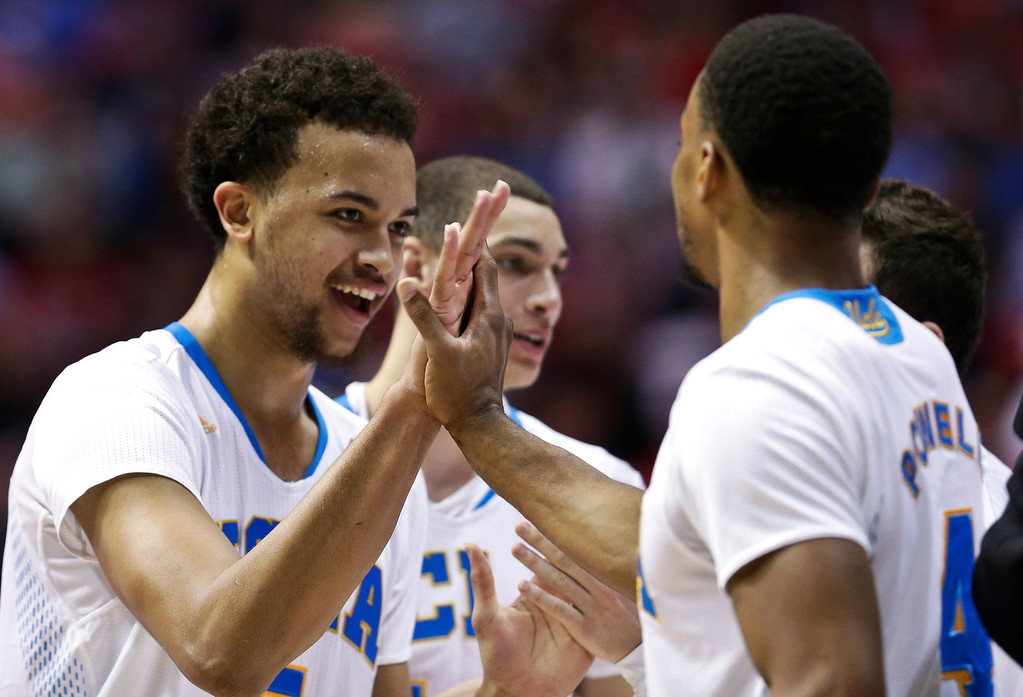 . UCLA \'s Kyle Anderson and Norman Powell, right, celebrate during the second half of a third-round victory over Stephen F. Austin in the NCAA college basketball tournament, Sunday, March 23, 2014, in San Diego. (AP Photo/Gregory Bull)