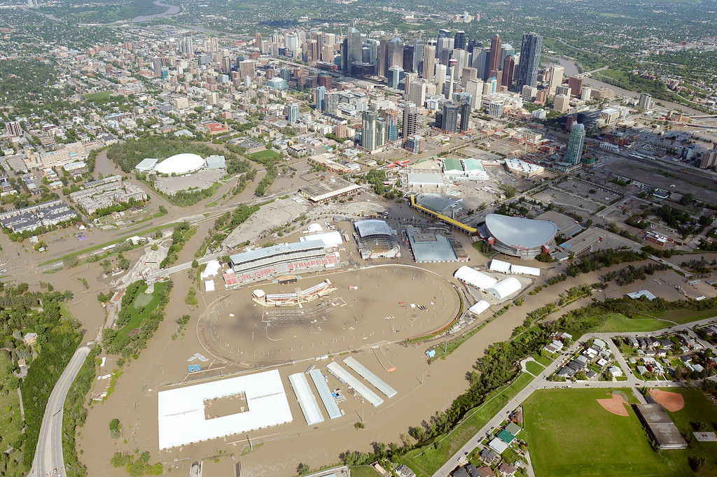 . This aerial photo shows the Calgary Stampede grounds immersed in water during heavy flooding in Calgary, Saturday, June 22, 2013.  (AP Photo/The Canadian Press, Jonathan Hayward)