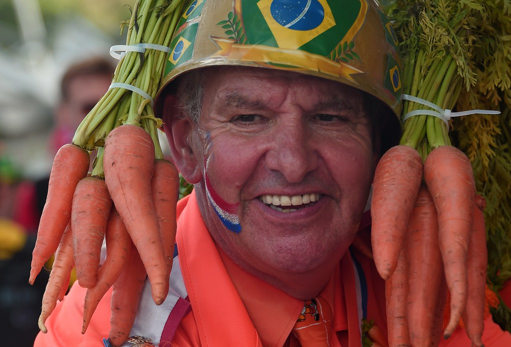 . A Dutch supporter smiles before a Group B football match between Spain and the Netherlands at the Fonte Nova Arena in Salvador during the 2014 FIFA World Cup on June 13, 2014.  AFP PHOTO / DAMIEN MEYER/AFP/Getty Images