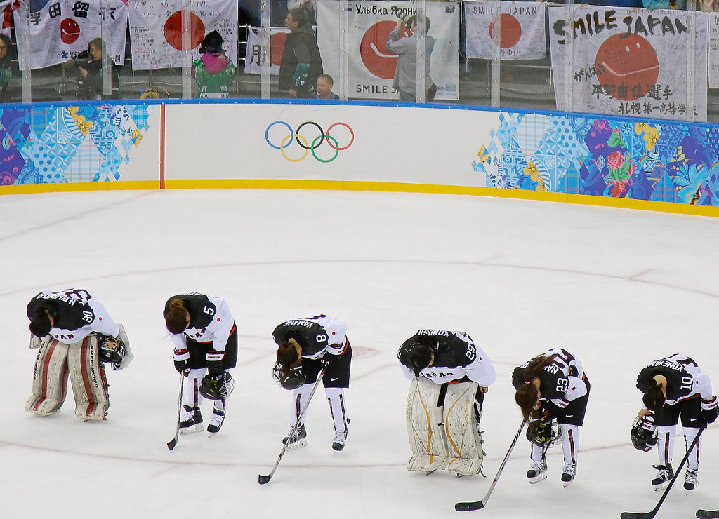 . Members of Team Japan bow after their 4-0 loss to Germany in the 2014 Winter Olympics women\'s ice hockey game at Shayba Arena, Thursday, Feb. 13, 2014, in Sochi, Russia. (AP Photo/Matt Slocum)