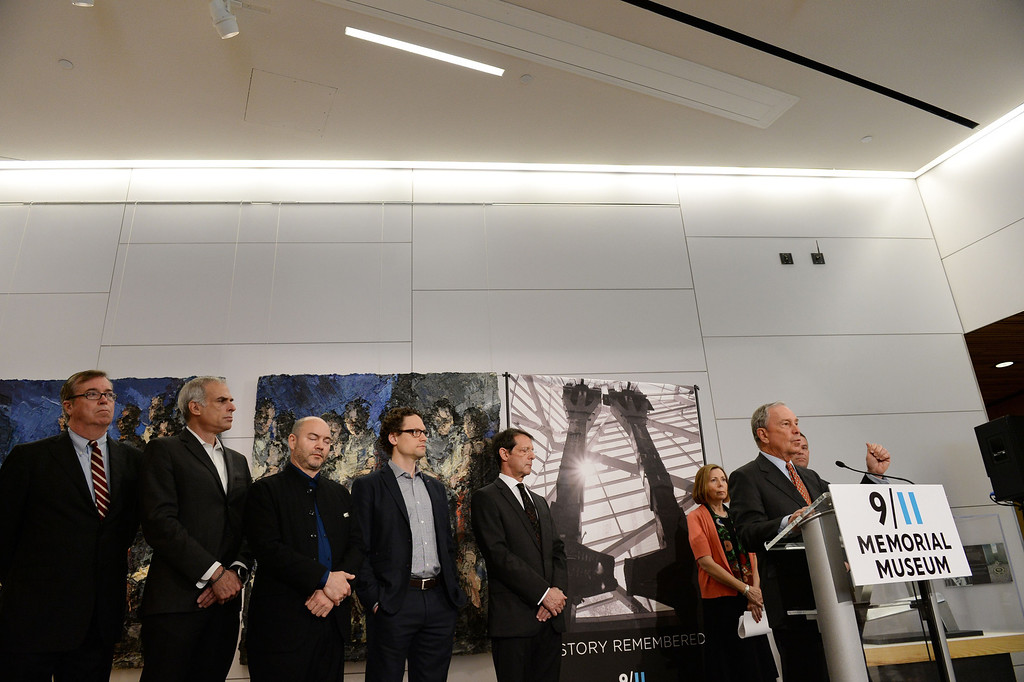. National September 11 Memorial & Museum Chairman Michael Bloomberg (at podium), speaks at a press conference before a press preview of the National September 11 Memorial Museum at the World Trade Center site May 14, 2014 in New York. AFP PHOTO/Stan HONDA/AFP/Getty Images