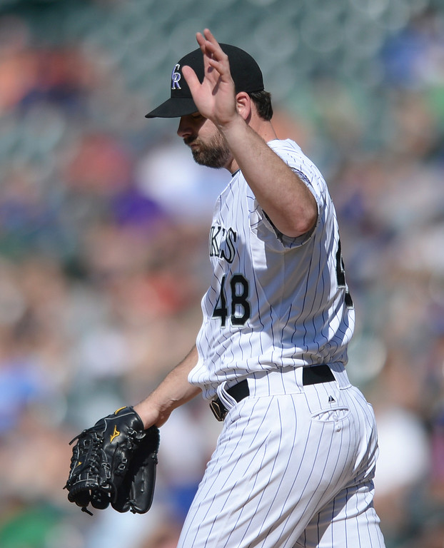 . DENVER, CO - JULY 5:  Colorado reliever Boone Logan acknowledged sarcastic applause from fans after he threw a strike in the seventh inning. The Colorado Rockies defeated the Los Angeles Dodgers 8-7 at Coors Field Saturday afternoon, July 5, 2014.  Photo by Karl Gehring/The Denver Post