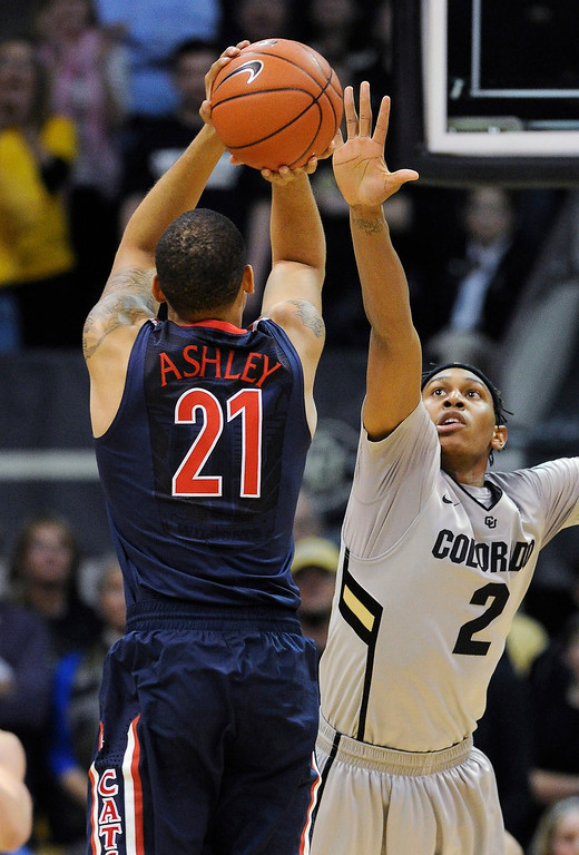. BOULDER, CO. - FEBRUARY 14: Colorado forward Xavier Johnson (2) tried to block a shot from Wildcats forward Brandon Ashley (21) in the first half. The University of Colorado men\'s basketball team hosted Arizona Thursday night, February 14, 2013 at the Coors Event Center in Boulder. (Photo By Karl Gehring/The Denver Post)