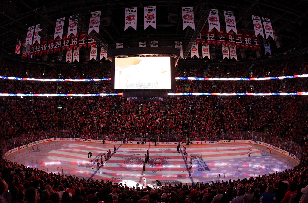. Montreal Canadiens  and the New York Rangers look on during the National Anthem prior to the start of Game Five of the Eastern Conference Final in the 2014 NHL Stanley Cup Playoffs at Bell Centre on May 27, 2014 in Montreal, Canada.  (Photo by Francois Laplante/FreestylePhoto/Getty Images)