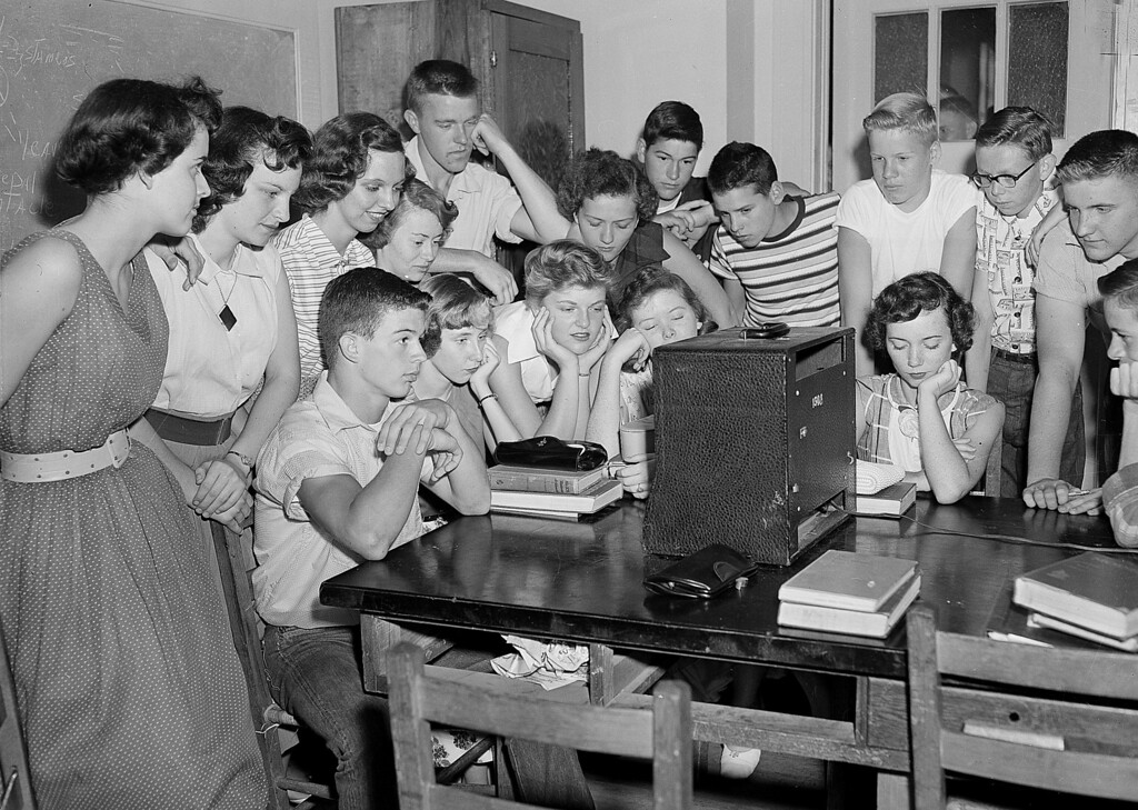 . A group of students at the Russell High School in Atlanta, Ga., gather around a radio shortly after noon to hear news that segregation has been ruled out in public schools in a unanimous Supreme Court decision on May 17, 1954.  (AP Photo/Horace Cort)