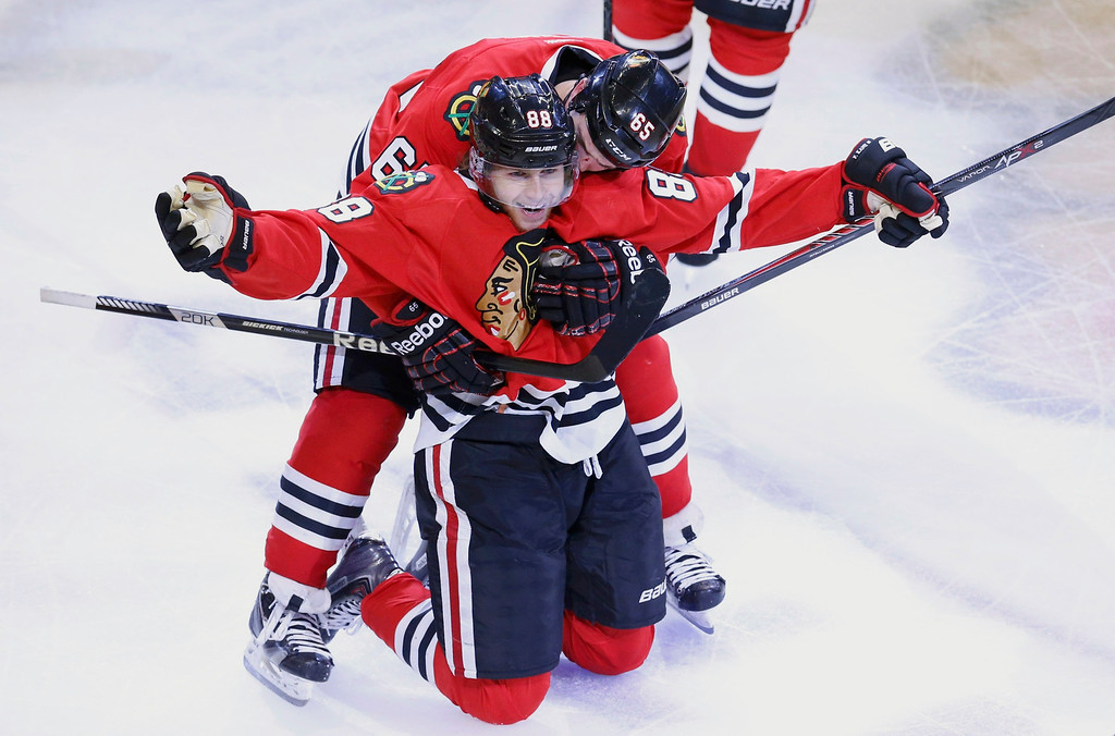 . Chicago Blackhawks\' Patrick Kane celebrates after scoring the gamne and series winning goal against the Los Angeles Kings with teammate Andrew Shaw during the second overtime in Game 5 of their NHL Western Conference final hockey playoff series in Chicago, Illinois, June 8, 2013.  REUTERS/Jim Young
