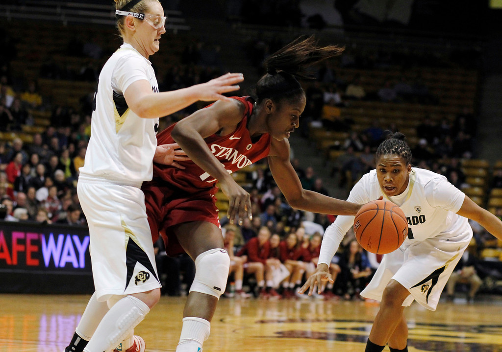 . Stanford forward Chiney Ogwumike, center, reaches out for the loose ball as Colorado forward Jen Reese, left, and guard Ashley Wilson cover during the first half of an NCAA women\'s college basketball game in Boulder, Colo., on Friday, Jan. 4, 2013. (AP Photo/David Zalubowski)