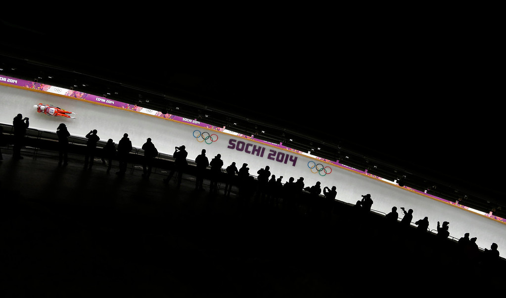 . The doubles team of Patryk Poreba and Karol Mikrut of Poland race down the track in their final run during the men\'s doubles luge at the 2014 Winter Olympics, Wednesday, Feb. 12, 2014, in Krasnaya Polyana, Russia. (AP Photo/Natacha Pisarenko)
