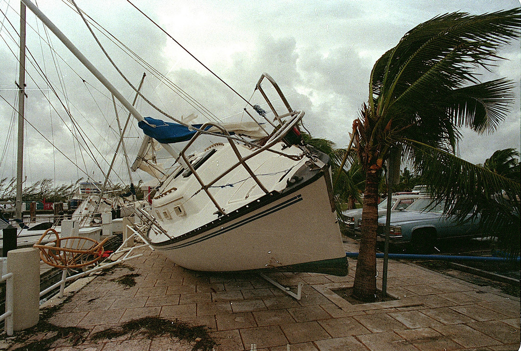 . In this Aug. 24, 1992 file photo, a sailboat sits on a sidewalk at Dinner Key in Miami after it was washed ashore by Hurricane Andrew. (AP Photo/Terry Renna, File)