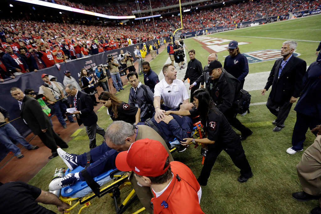 . Houston Texans head coach Gary Kubiak is taken off the field on a stretcher during the second quarter of an NFL football game against the Indianapolis Colts, Sunday, Nov. 3, 2013, in Houston. (AP Photo/David J. Phillip)