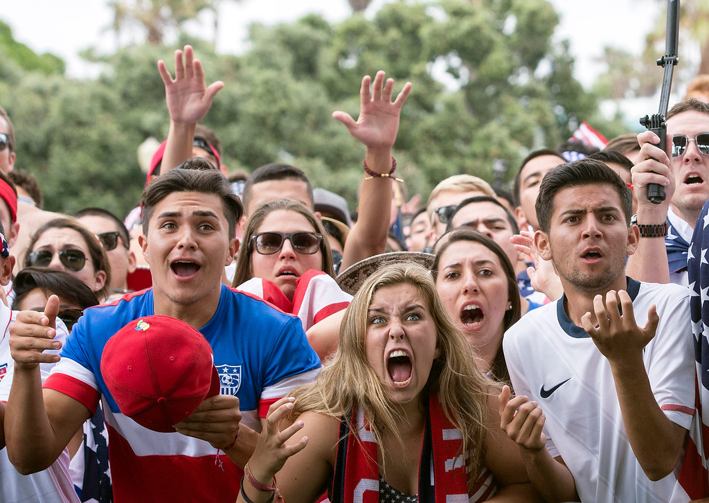 . Soccer fans react as they watch a televised broadcast of the World Cup soccer match at Veteran\'s Park in Redondo Beach, Calif., Tuesday, July 1, 2014, as Belgium scores against the United States during the extra time at World Cup viewing party. (AP Photo/The Orange County Register, Kyusung Gong)