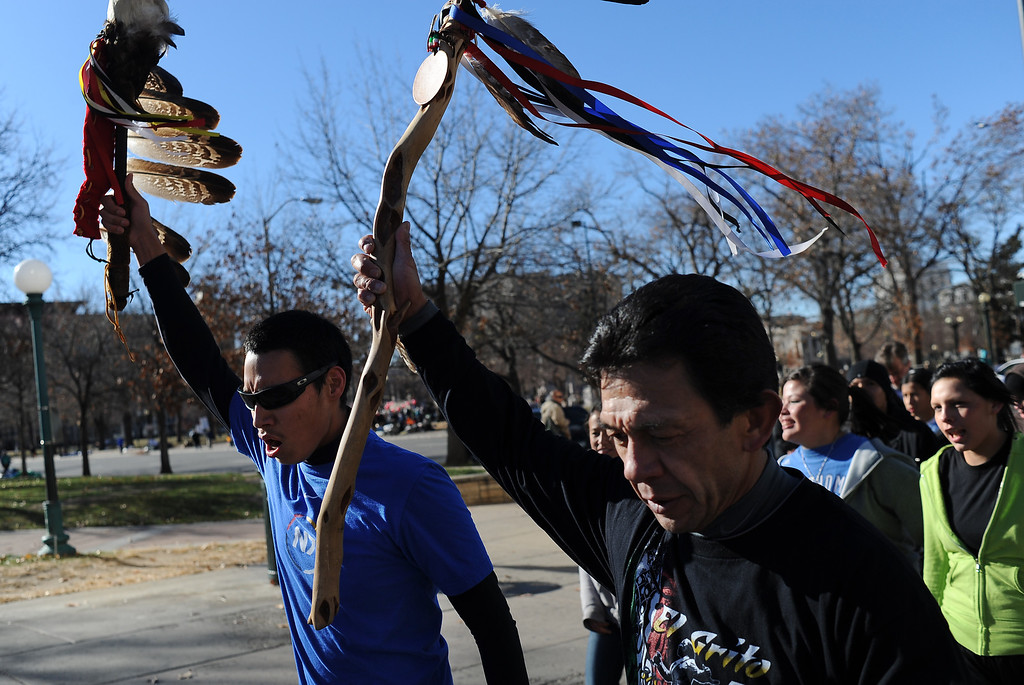 . DENVER, CO--NOVEMBER 26, 2011--Kaden Walks Nice, left, and Nick Diaz lead runners and walkers down Colfax Ave.  Nov. 26, 2011 during the final day of the 13th Annual Sand Creek Massacre Spiritual Healing Run in Denver that started at the Sand Creek Massacre National Historic Site and ended on the west steps of the State Capitol Building.   Photo by Leah Millis/Special to The Denver Post