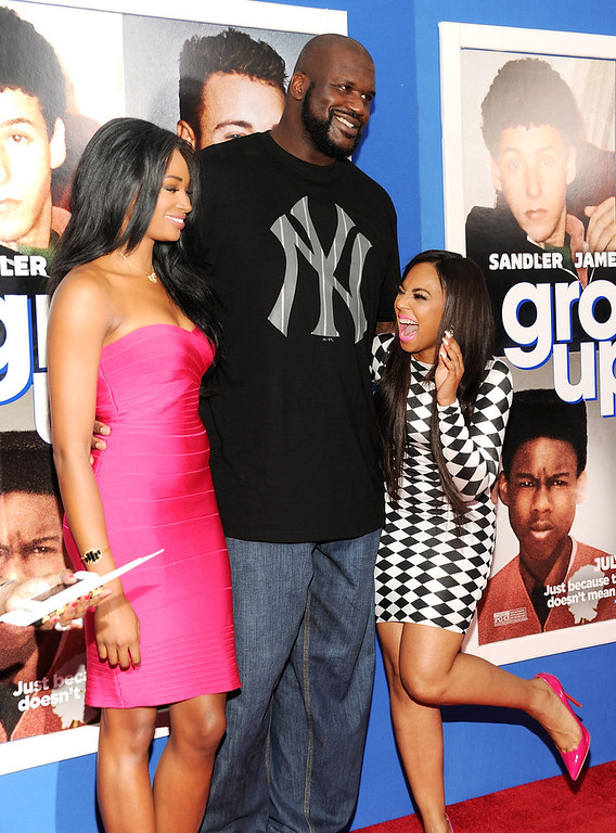 ". Retired basketball player Shaquille O\'Neal, center, poses with former Miss USA Nana Meriwether, left, and singer Ashanti Douglas at the premiere of ""Grown Ups 2\"" at the AMC Loews Lincoln Square on Wednesday, July 10, 2013 in New York. (Photo by Evan Agostini/Invision/AP)"