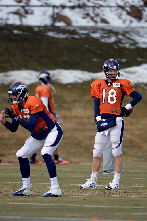 . Denver Broncos quarterback Peyton Manning (18) looks on during practice January 15, 2014 at Dove Valley. The Broncos are preparing for their game against the New England Patriots in the AFC championship game.  (Photo by John Leyba/The Denver Post)