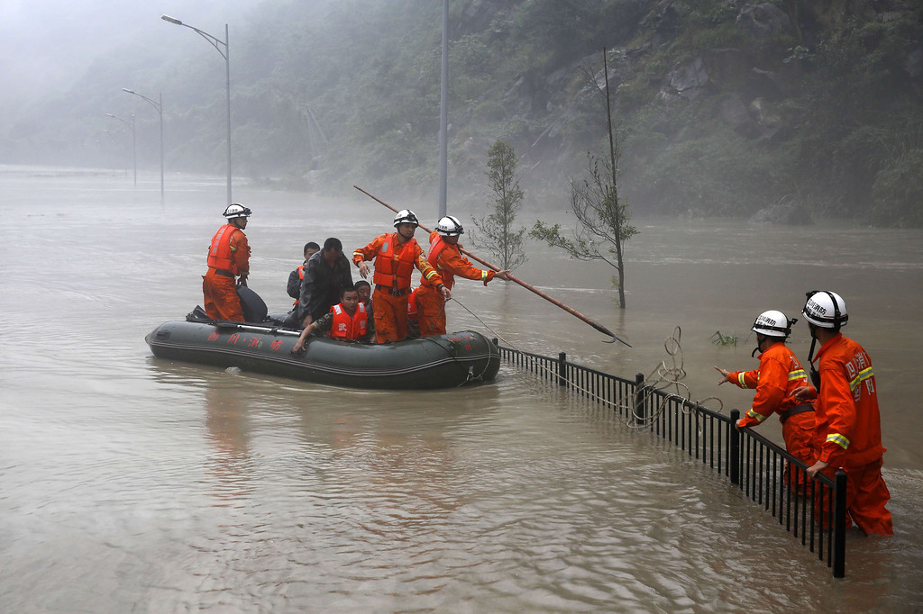 . Rescuers look for victims as heavy flood waters sweep through Beichuan in southwest China\'s Sichuan province. Rainstorms sweeping across parts of China have affected millions, causing landslides and disabling transportation in provinces such as Sichuan and Yunnan, state media reported.  AFP/Getty Images