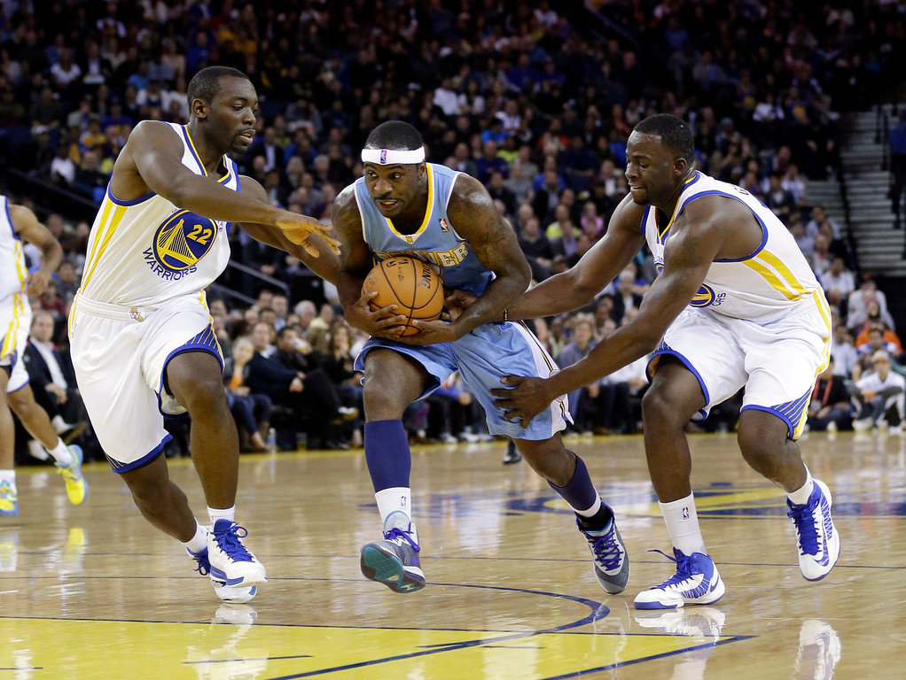 . Denver Nuggets\' Ty Lawson, center, tries to dribble through Golden State Warriors\' Charles Jenkins (22) and Draymond Green during the first half of an NBA basketball game in Oakland, Calif., Thursday, Nov. 29, 2012. (AP Photo/Marcio Jose Sanchez)