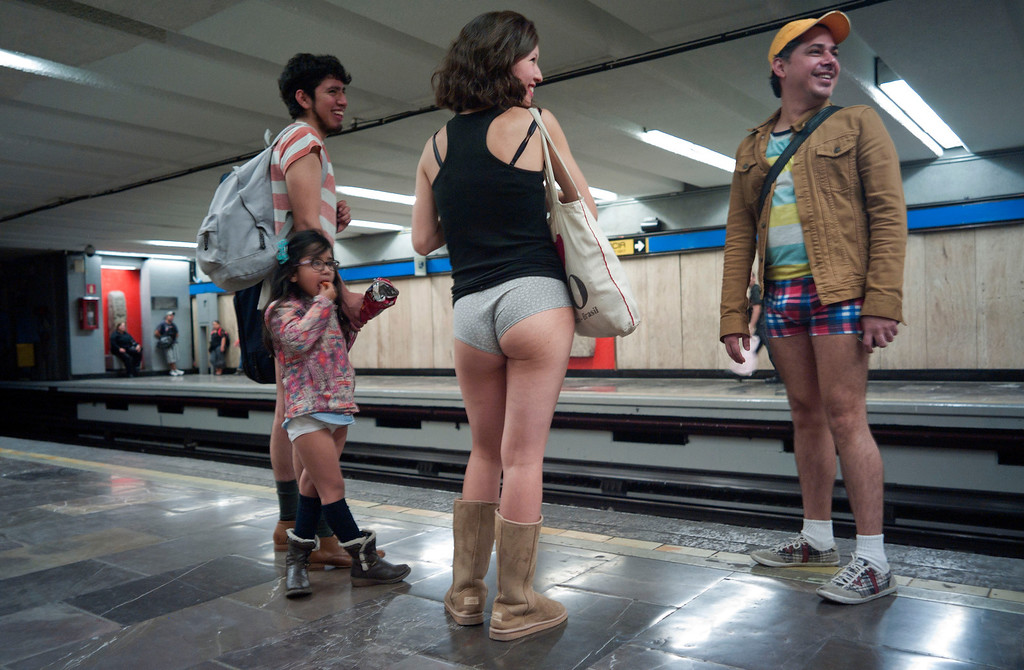 ". People taking part in the ""No Pants Subway Ride\"" wait at a metro station in Mexico City on January 12, 2014. \""No Pants Subway Ride\"" is an annual event in which transit passengers ride trains without wearing pants on January. The event is observed in dozens of cities worldwide.  ANTONIO NAVA/AFP/Getty Images"