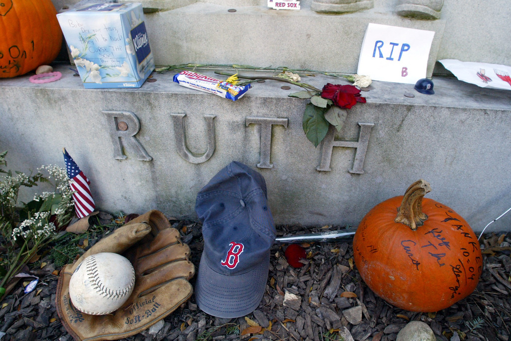 ". The grave of George Herman \'Babe\'\' Ruth is decorated with items left by New York Yankees and Boston Red Sox fans, Thursday, Oct. 28, 2004 in Hawthorne. The ""Curse of the Bambino\"" has followed Boston through four World Series defeats, each one in seven games. The end of the drought came Wednesday, Oct. 27, when Boston completed a sweep of the St. Louis Cardinals to win the World Series (AP Photo/Mary Altaffer)"