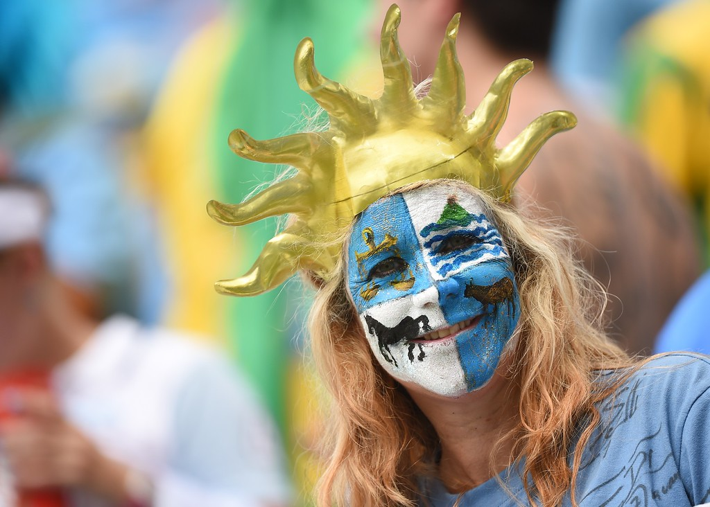 . A Uruguay fan cheers their team prior to the Group D football match between Italy and Uruguay at the Dunas Arena in Natal during the 2014 FIFA World Cup on June 24, 2014.  AFP PHOTO / EMMANUEL  DUNAND/AFP/Getty Images