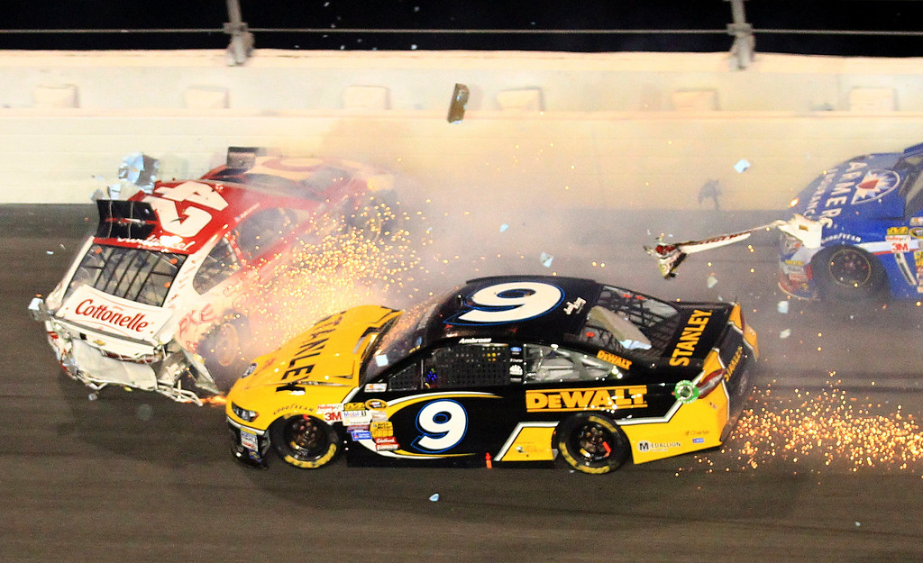 . Kyle Larson (42) and Marcos Ambrose (9) crash during the NASCAR Daytona 500 Sprint Cup series auto race at Daytona International Speedway in Daytona Beach, Fla., Sunday, Feb. 23, 2014. (AP Photo/John Chilton)