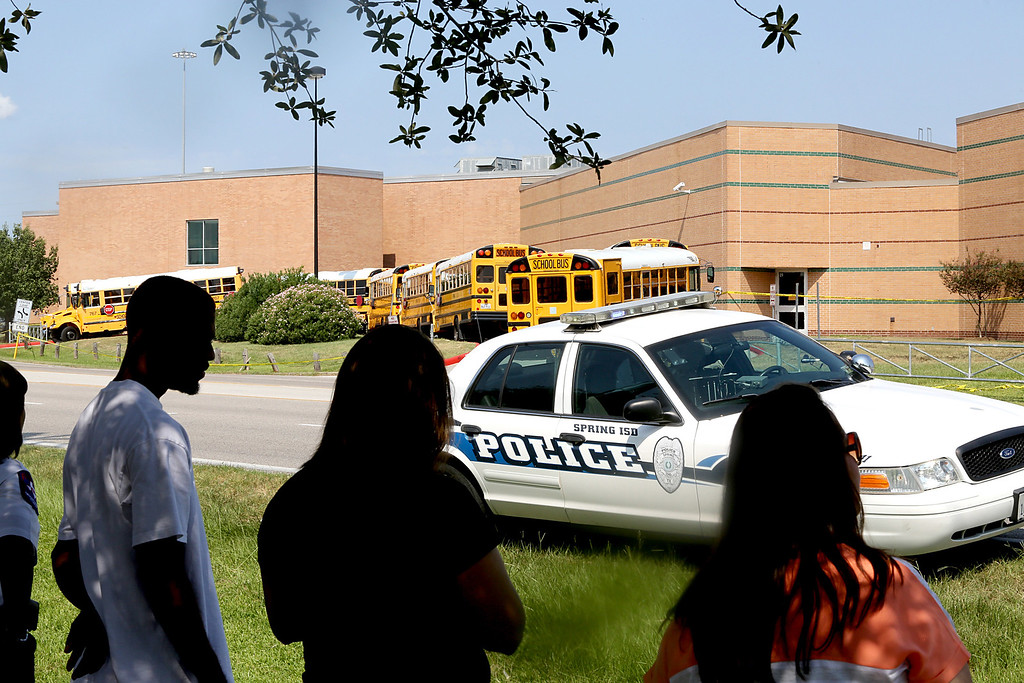 . Spring High School parents wait across the street from Spring High School for their children to be released from a lockdown after a stabbing at the school September 4, 2013 in Spring, Texas.  (Photo by Thomas B. Shea/Getty Images)