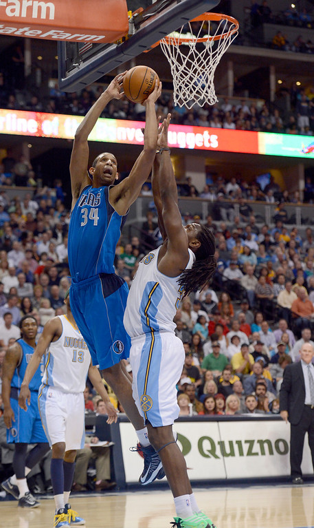 . DENVER, CO. - APRIL 04: Brandan Wright (34) of the Dallas Mavericks goes up for a shot over Kenneth Faried (35) of the Denver Nuggets during the fourth quarter April 4,  2013 at Pepsi Center. (Photo By John Leyba/The Denver Post)