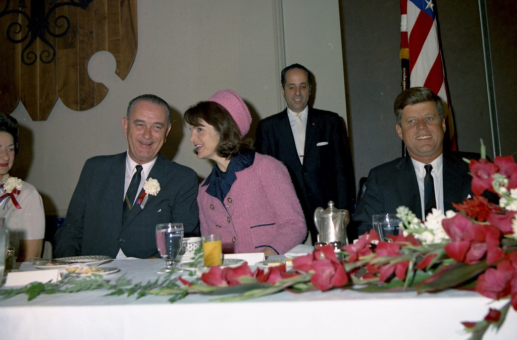 . The Kennedys attend the Fort Worth Chamber of Commerce breakfast with Lady Bird Johnson and  Vice President Lyndon Johnson. Cecil Stoughton/John F. Kennedy Presidential Library and Museum
